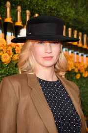 January Jones arrived for the Veuve Clicquot Polo Classic rocking a black Eugenia Kim hat.