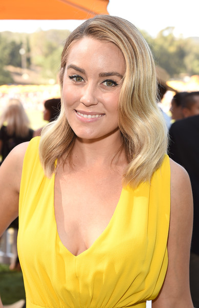Lauren Conrad looked very pretty with her vintage-chic waves at the Veuve Clicquot Polo Classic.