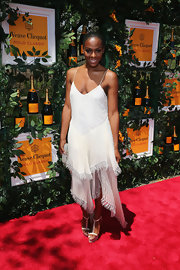Tika Sumpter looked effortlessly chic in a white frock that featured spaghetti straps, a tiered skirt, and an asymmetrical hem.