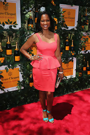 Garcelle Beauvais showed off her curves with this pink peplum dress.
