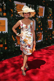 Tiffani Thiessen chose a printed floral frock for her look on the red carpet.