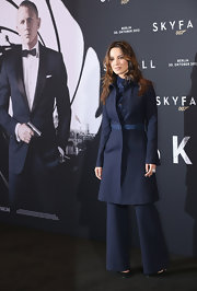 The whittled waist and A-line silhouette of Berenice's navy coat exuded modern sophistication.