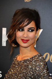 We love Berenice's ombre side-swept bangs and pinned updo.