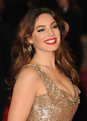 Kelly Brook made sure not one inch of her outfit went without sparkle—these glitzy gold earrings included!