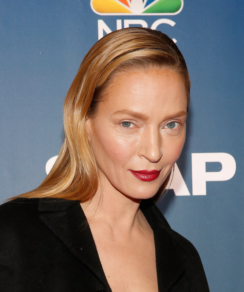 Uma Thurman was all about minimalism with her slicked-down hairstyle and barely-there makeup at the premiere of 'The Slap.'
