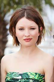 Emily Browning styled her short tresses in a center part straight cut for the 'Sleeping Beauty' photo call in Cannes.
