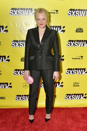 Elizabeth Moss punctuated her black look with a pink clutch by Jeffrey Levinson.