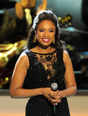 Jennifer Hudson wore her hair in a voluminous half-up style with long sleek curls while performing at the opening of the Smith Center for the Performing Arts in Las Vegas.