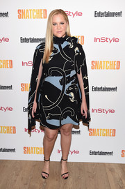 Amy Schumer hit the New York premiere of 'Snatched' looking stylish in a caped print dress by Valentino.