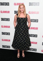 Amy Schumer was summer-glam in a flared black print dress by Erdem at the special screening of 'Snatched.'