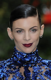 Liberty Ross wore a deep berry lipstick layered over with a glimmering golden gloss.