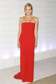 It doesn't get more glamorous than a strapless red gown like Jamie Tisch's.