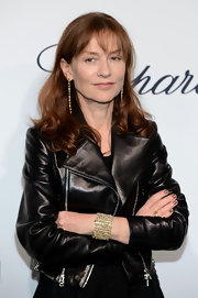 Isabelle Huppert's intricate cuff bracelet and dangling earrings provided a glam contrast to her tough leather look.