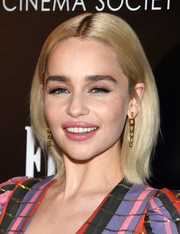 Emilia Clarke accessorized with a pair of gold dangle earrings by Deborah Pagani.