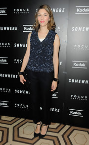 Sofia Coppola looked mature in black suede pumps. The heels feature dainty ankle straps for a girlish touch.