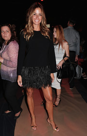 Kelly Bensimon dolled up her top with a black feather mini skirt.
