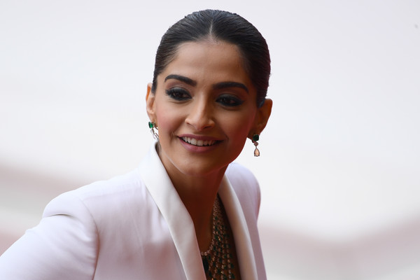 Sonam Kapoor Classic Bun [face,skin,eyebrow,lady,smile,chin,forehead,lip,photography,businessperson,sonam kapoor,once upon a time in hollywood,screening,cannes,france,red carpet,the 72nd annual cannes film festival,cannes film festival]