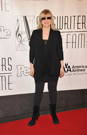 Stevie Nicks looked so lovely and feminine in a draped black blouse.