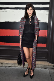 Caroline Sieber looked flawlessly styled in an ankle-length Chanel tweed coat layered over a black button-down and mini skirt during the Sonia Rykiel fashion show.