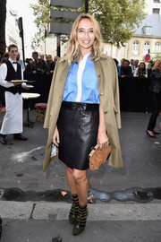 Alexandra Golovanoff paired a black leather pencil skirt with a blue and white button-down for the Sonia Rykiel fashion show.