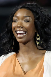 Brandy's gold, chandelier earrings made a bold statement at the Sony Ericsson Open. They made a great accent for her