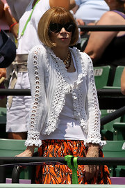Anna wore a crocheted cardigan with her banana print Prada skirt at the Crandon Park Tennis Center.