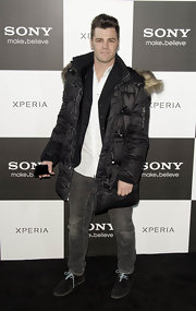Fonsi Nieto bundled up with this black down jacket with fur-trimmed hood.