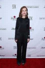 Isabelle Huppert kept it understated in a long-sleeve black jumpsuit by Nehera at the Sony Pictures Classics' pre-Academy Awards dinner.
