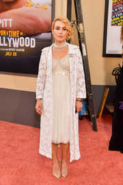 Noomi Rapace attended the LA premiere of 'Once Upon a Time in Hollywood' wearing an alluring white cocktail dress.