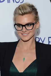 Eliza Coupe added an 18-carat gold and green malachaite necklace to her ensemble.