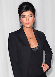 Jessica Szohr attended the Sony PlayStation unveiling of the PS VITA portable entertainment station wearing a dark inky polish to complement her all-black ensemble.