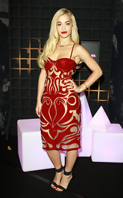Rita Ora showed just a touch of skin with this ruby red cutout detail dress.