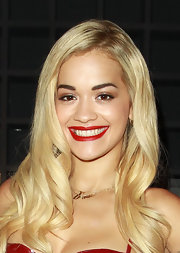 Rita showed off her platinum locks with loose waves.