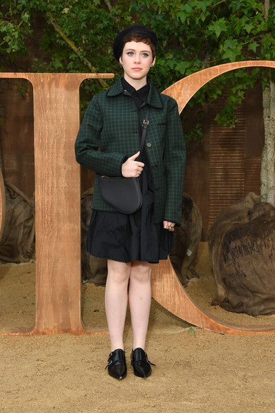 Sophia Lillis Leather Slip On Shoes [clothing,lady,fashion,outerwear,leg,tights,photography,uniform,coat,shoe,christian dior,sophia lillis,part,summer 2020,paris,france,christian dior womenswear spring,photocall - paris fashion week,show,paris fashion week]