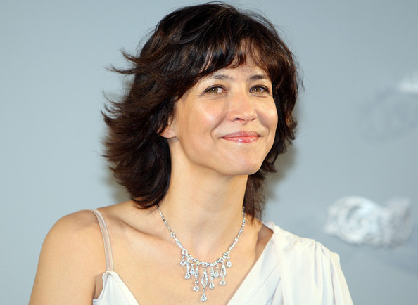 Sophie Marceau Diamond Chandelier Necklace [hair,face,hairstyle,chin,lady,layered hair,lip,forehead,human,brown hair,sophie marceau,ebisu garden place,tokyo,japan,chaumet,chaumet 230th anniversary,press conference]