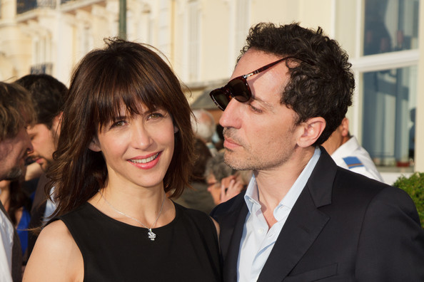 Sophie Marceau Medium Straight Cut with Bangs [hair,eyewear,hairstyle,event,glasses,interaction,vision care,smile,formal wear,premiere,actors,sophie marceau,gad elmaleh,l-r,cabourg,france,cabourg film festival,26th cabourg romantic film festival]