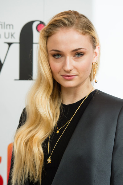 Sophie Turner Side Sweep [sky women in film tv awards,sophie turner,hair,face,blond,hairstyle,beauty,eyebrow,long hair,lip,chin,yellow,london hilton,england]