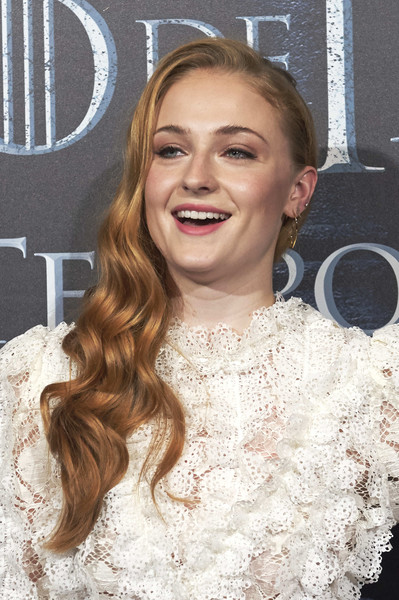 Sophie Turner Side Sweep [game of thrones,cinema,hair,face,hairstyle,eyebrow,blond,lip,long hair,beauty,skin,dress,sophie turner,sophie turner attends,palafox,madrid,spain,fans event,fan event]