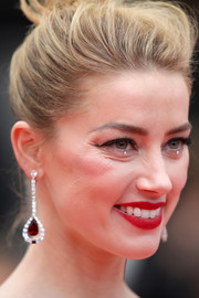 Amber Heard perked up her beauty look with a swipe of matte red lipstick for the Cannes Film Festival screening of 'Sorry Angel.'