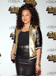 Marsha Ambrosius looked sporty and chic at the same time in her gold and black track jacket.