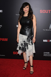 Rosie Perez looked very curvy in a fitted black leather top during the New York premiere of 'Southpaw.'