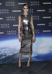 Cara Delevingne matched her frock with a pair of silver Aquazzura pumps.