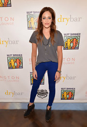Carly Chaikin paired a casual v-neck tee with colored pants for a cool and hip look.