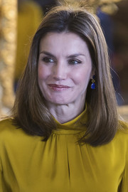 Queen Letizia of Spain's blue hydrothermal quartz and amber earrings by Tous made a gorgeous contrast to her mustard-yellow blouse.