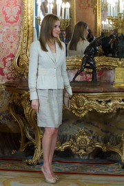 Princess Letizia looked smart and stylish in a gray skirt suit during an audience for the National Armed Forces Day.