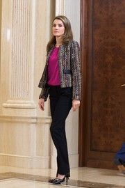 Princess Letizia went for casual sophistication in a cropped tweed jacket layered over a magenta blouse during an audience at Zarzuela Palace.