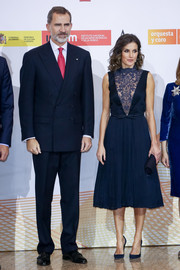 Queen Letizia of Spain looked darling in a navy cocktail dress with a lace-panel bodice and a pleated skirt while attending a concert to commemorate the 40th anniversary of the Spanish Constitution.