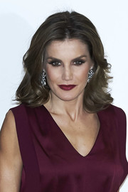 Queen Letizia of Spain swiped on some red lipstick to complement her outfit.
