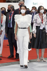 Queen Letizia of Spain looked girly in a white jumpsuit with ruffled sleeves at the FITUR Tourism Fair opening.