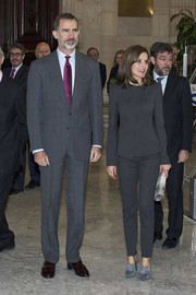 Queen Letizia of Spain sported a monochromatic ensemble, consisting of a pair of Magrit loafer heels and a Hugo Boss pantsuit, during a meeting at the National Library in Madrid.